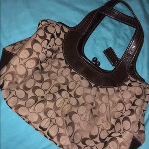 Coach Medium sized Brown Monogram Purse.